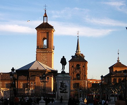The Church of Santa María la Mayor (background) where Cervantes was baptized in Alcalá de Henares. The square in front of it is now called Plaza Cervantes - Miguel de Cervantes
