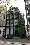 foto van Hoekhuis met gevel onder rechte lijst en dakkapel