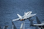 An F-A-18C Hornet launches from the flight deck of USS George H.W. Bush. (33916451766).jpg