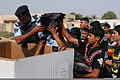 An Iraqi Police officer from distributes school supplies to students who attend the Tunis Primary School, Tunis, Iraq, Oct 111003-A-OB692-400.jpg