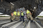 An RAF C17 aircraft is loaded with aid from the British people, headed for people affected by the earthquake in Nepal (16672019523).jpg