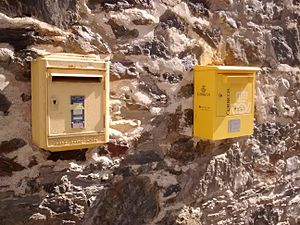 Postal services in Andorra - A French post box (left) and a Spanish post box (right) side by side in L'Aldosa de la Massana