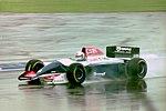 Andrea de Cesaris - Tyrrell 021 during practice for the 1993 British Grand Prix (33302878150).jpg