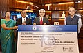 Arun Jaitley being presented a dividend cheque by the CMDs (Joint Charge), The New India Assurance Company Ltd., Shri Hemant G. Rokade, Director & General Manager and Shri C. Narambunathan, Director.JPG