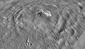 Ascraeus Mons - Flank terraces on slopes of Ascraeus Mons give the volcano's northwestern (left) and southeastern flanks (right) a rumpled appearance. Note the numerous depressions and channels on the volcano's southwestern flank (bottom). Vertical exaggeration is 3x. Image is THEMIS IR daytime mosaic overlain on MOLA topography.
