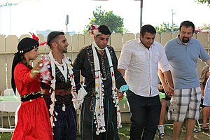 Group dance - Assyrian people dancing khigga, a group dance, which is the common dance among Assyrians.