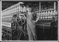 At machine is Stanislaus Beauvais, has worked in spinning room for two years. Salem, Mass. - NARA - 523485.tif