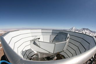 Atacama Cosmology Telescope - The Atacama Cosmology Telescope viewed from the top of the outer ground screen. The top half of the segmented, primary mirror can be seen above the inner ground screen that moves with the telescope.