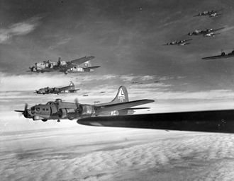"""381st Training Group - B-17s of the 381st Bomb Group, Ridgewell Airfield England, en route to targets over Nazi-occupied territory. The aircraft in the foreground is Boeing B-17G-70-BO Flying Fortress, AAF Ser. No. 42-31443 """"Friday the 13th"""" of the 532d Bomb Squadron. This aircraft was lost on 22 February 1944 on a mission to Oschersleben, Germany."""