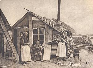 Great Retreat (Russian) - Peasants from a destroyed village in front of a shack constructed from debris, environs of Warsaw, 1915