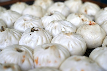Bāozi are steamed buns containing savoury or sweet combinations of meat, vegetables, and mushrooms, traditionally associated with breakfast.