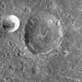 Barkla (crater) - Barkla (upper center) from Apollo 15.  The smaller, brighter crater at upper left is Langrenus M.  NASA photo.