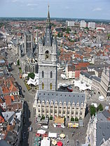 Belfry of Ghent. Saint Nicholas church is visible in the background.