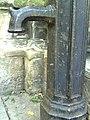 Benchmark and pump at St Mary's Church - geograph.org.uk - 2045818.jpg