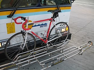 Highway 17 Express - Bike rack on a Highway 17 Express bus, holding a bike in one of three slots.