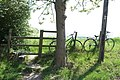 Bikes by the stile - geograph.org.uk - 796885.jpg
