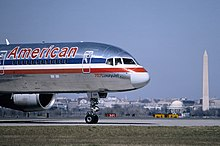 A Boeing 757, registration N64AAA, at Ronald Reagan Washington National Airport in March 1995