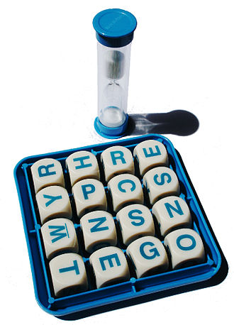Boggle - A grid of Boggle cubes and a sand timer