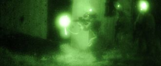 Friendly fire - Soldiers perform a night assault at Camp Atterbury Joint Maneuver Training Center September 21, during Bold Quest 2011, a Joint Staff lead coalition combat assessment exercise to test the interoperability of target identification systems of member nations to reduce friendly fire incidents.