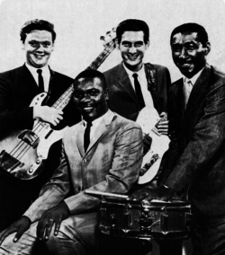 "Booker T. & the M.G's c. 1967 (L-R): Donald ""Duck"" Dunn, Booker T. Jones (seated), Steve Cropper, Al Jackson Jr."