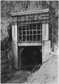 Boulder Canyon Outlet portal of diversion tunnel No. 2 showing Stoney gate steel in place above portal and form work... - NARA - 293802.tif