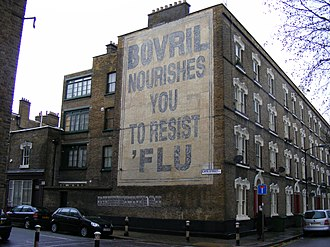 The King's Speech - The Pullens buildings with a 1930s advertisement.