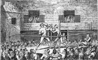 Tom Spring - A boxing match in the early 19th century. Often held in warehouses, courtyards of Inns, or open fields away from the eyes of local authorities.