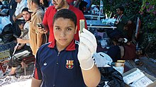 Boy shows shotgun shell after mass killings in Cairo 27-July-2013.jpg