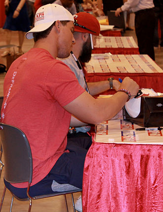 Brian Cushing - Cushing signs autographs at a Houston sports collectors show in June 2014.