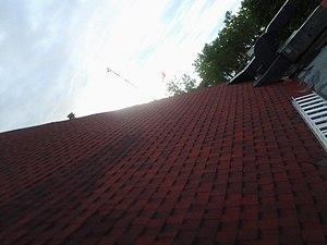 Britannia Yacht Club roof, flagpole and ladder.JPG