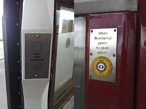 Retrofitting - In this example of retrofitting, a set of modern door opening buttons have been retrofitted to this British Rail Class 483 EMU, which was derived from 1938 tube stock.