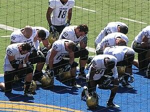 Colorado player say a prayer before a road gam...
