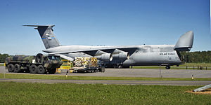 137th Airlift Squadron - 137th AS C-5A Galaxy (s/n 70-0460) sits on the flightline before cargo is loaded on 5 September 2005 by Airmen with the 109th Aerial Port Squadron at the Albany International Airport. The cargo was bound for Gulfport, Mississippi, in support of Hurricane Katrina relief operations.