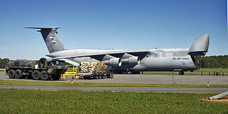 105th Airlift Wing - 137th AS C-5A Galaxy (s/n 70-0460) sits on the flightline before cargo is loaded on 5 September 2005 by airmen with the 109th Aerial Port Squadron at the Albany International Airport. The cargo was bound for Gulfport, Mississippi, in support of Hurricane Katrina relief operations.
