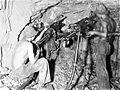 COLLECTIE TROPENMUSEUM Mijnwerkers ondergronds aan het werk met boormachines Raja TMnr 10007211.jpg
