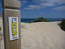 Picture of Cape to Cape track marker on a beach.