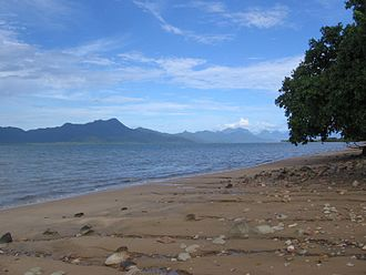 Oyster Point (Australia) - Oyster Point, protruding into the Hinchinbrook channel (right), viewed from Cardwell. The mountains on the left are Hinchinbrook Island.