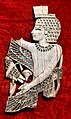 Carved ivory from Nimrud. Winged Egyptian man, 9th to 7th century BCE. From Nimrud, Iraq. Iraq Museum.jpg