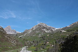 Castelmagno: at right the Santuario di San Magno (Saint Magnus's sanctuary), on background at center the Reina peak and at his feet the Grana valley