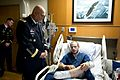 Chief of Staff of the Army Gen. Raymond T. Odierno listens as U.S. Army Sgt. Kusch describes his injury.jpg