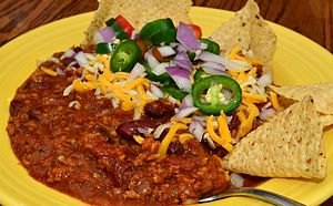 Tex-Mex - Chili with garnishes and tortilla chips