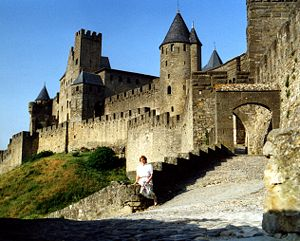 Cité de Carcassonne, woman on wall