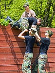 Civil Air Patrol Cadets work together to overcome a wall at the conditioning course at Camp Atterbury, Indiana.jpg