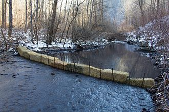 Coal slurry - A 2014 coal slurry spill into a river at Patriot Coal, West Virginia. A straw impoundment has been created across the river to try to hold the spillage.