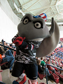 South Carolina Stingrays mascot Cool Ray wearing a military themed jersey and a patriotic top hat.