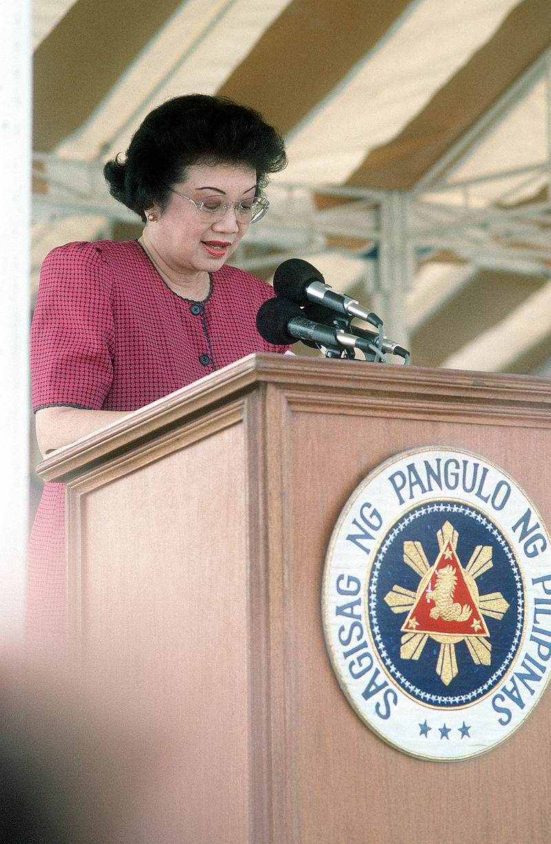 "Philippine  President Corazon Aquino addresses base workers at a rally at Remy  Field concerning jobs for Filipino workers after the Americans withdraw  from the U.S. facilities. | Photo by ""Talaksan:Corazon Aquino 1992"" by Wikipedia is in the Public Domain"