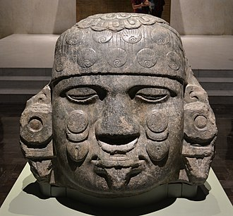 Coyolxāuhqui - Head of Coyolxauhqui; circa 1500; diorite; 80 x 80 x 65 cm; National Museum of Anthropology (Mexico City). As usual, she is shown decapitated and with closed eyelids, as she was beheaded by her brother, Huitzilopochtli