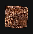 Cuneiform tablet case impressed with four cylinder seals in Assyrian and Anatolian styles, for cuneiform tablet 66.245.17a- loan of silver MET DP-13441-013.jpg