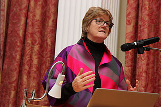 Photo shows Dame Sally Davies speaking at a podium