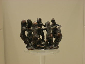 Greek dances - Women dancing. Ancient Greek bronze, 8th century BCE, Archaeological Museum of Olympia.